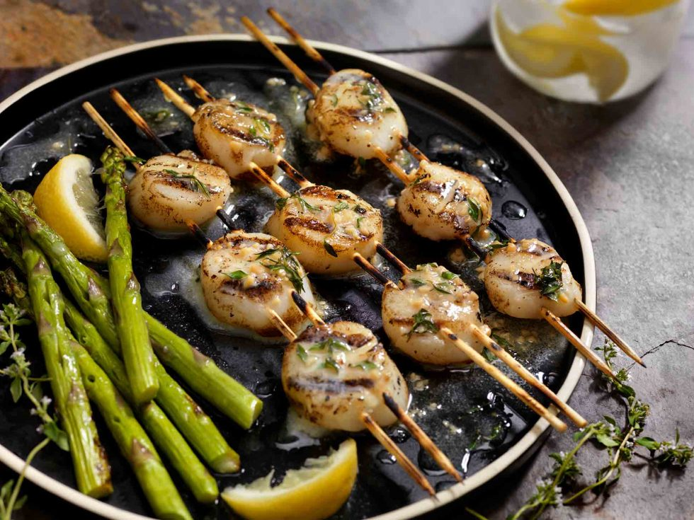 Calgary Food Photography. Buttered up and seasoned scallop skewers with lemon and asparagus.