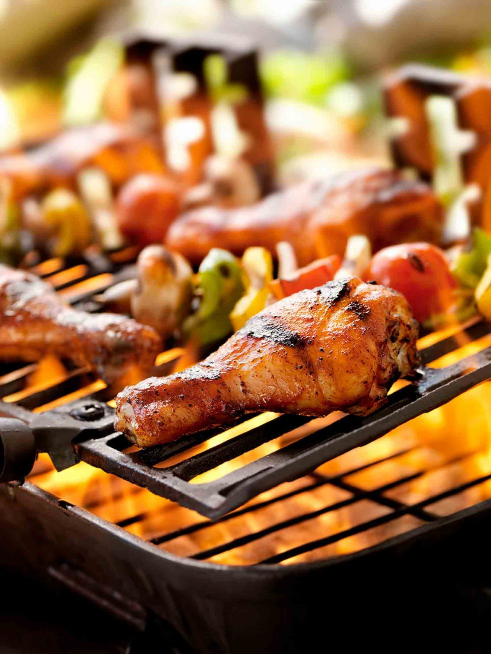 Calgary Food Photography. Chicken drumsticks and veggie skewers on the barbeque.