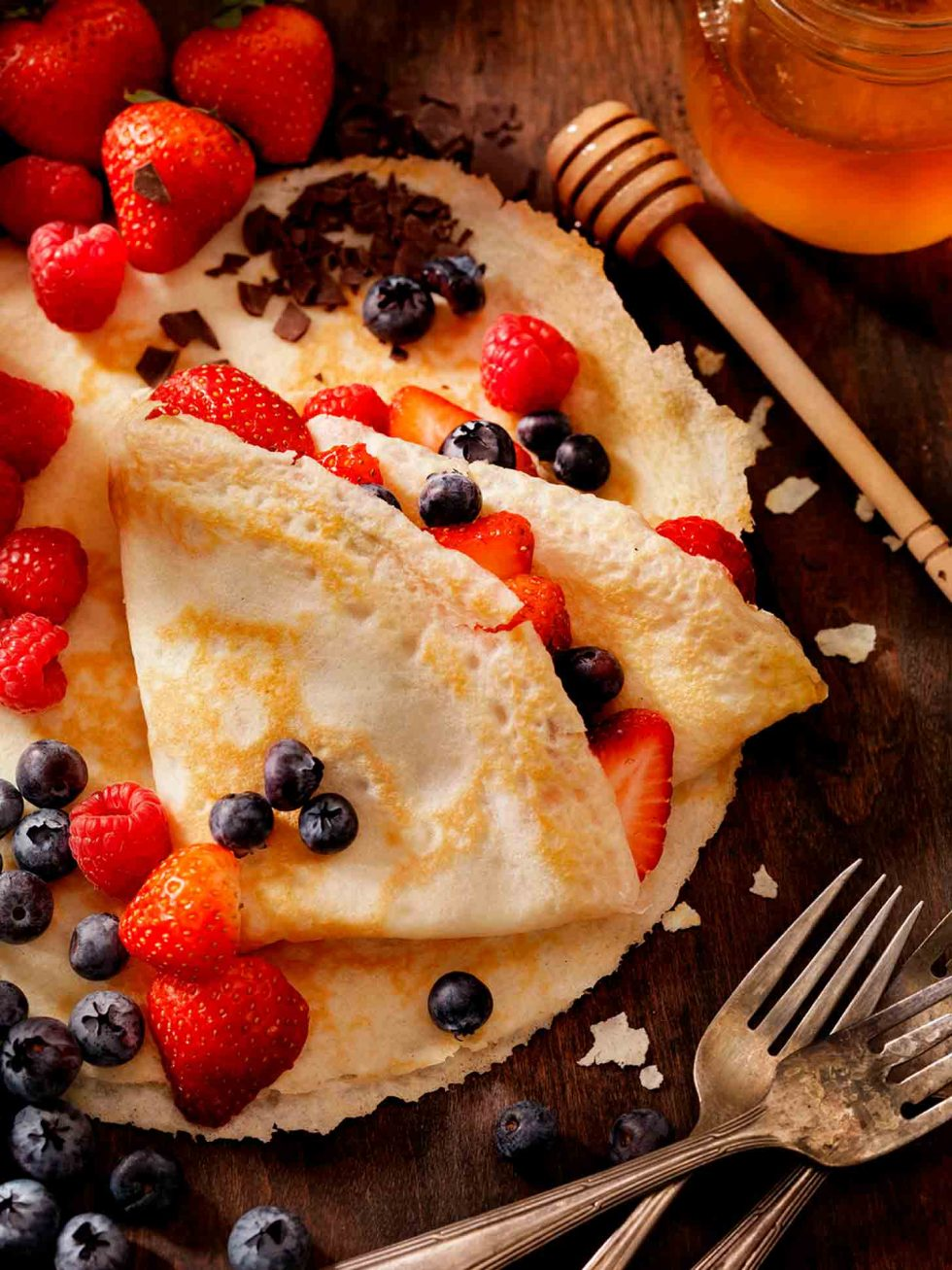 Calgary Food Photography. Crepes and berries on rustic backdrop.