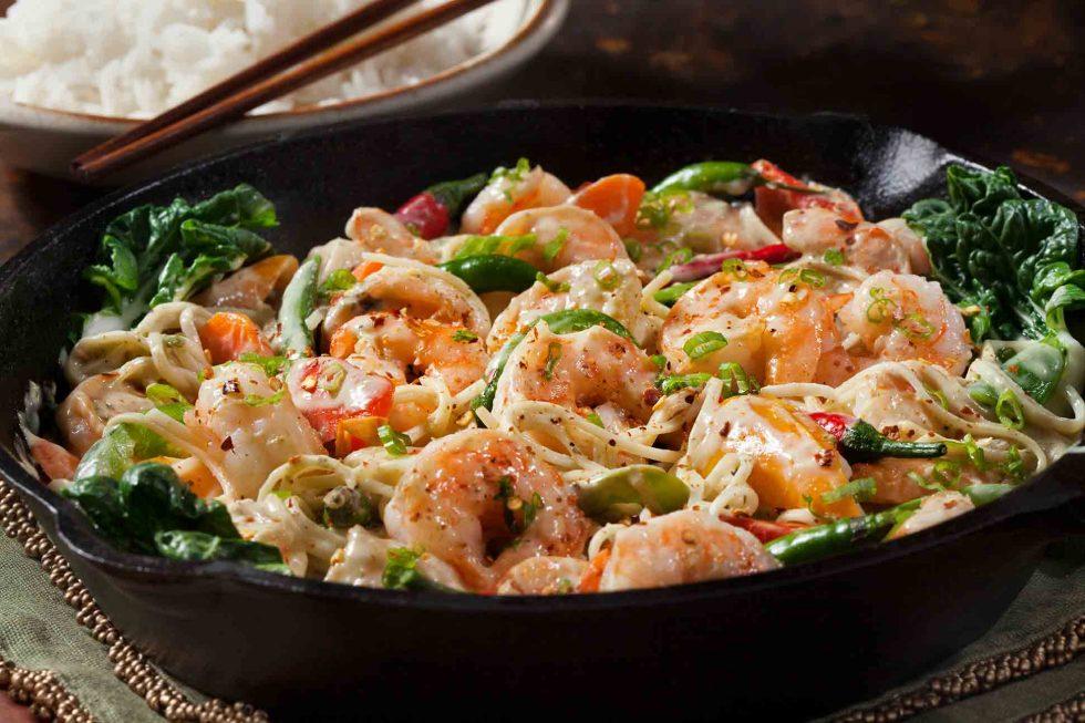 Calgary Food Photography. Garnished dish of shrimp pasta.