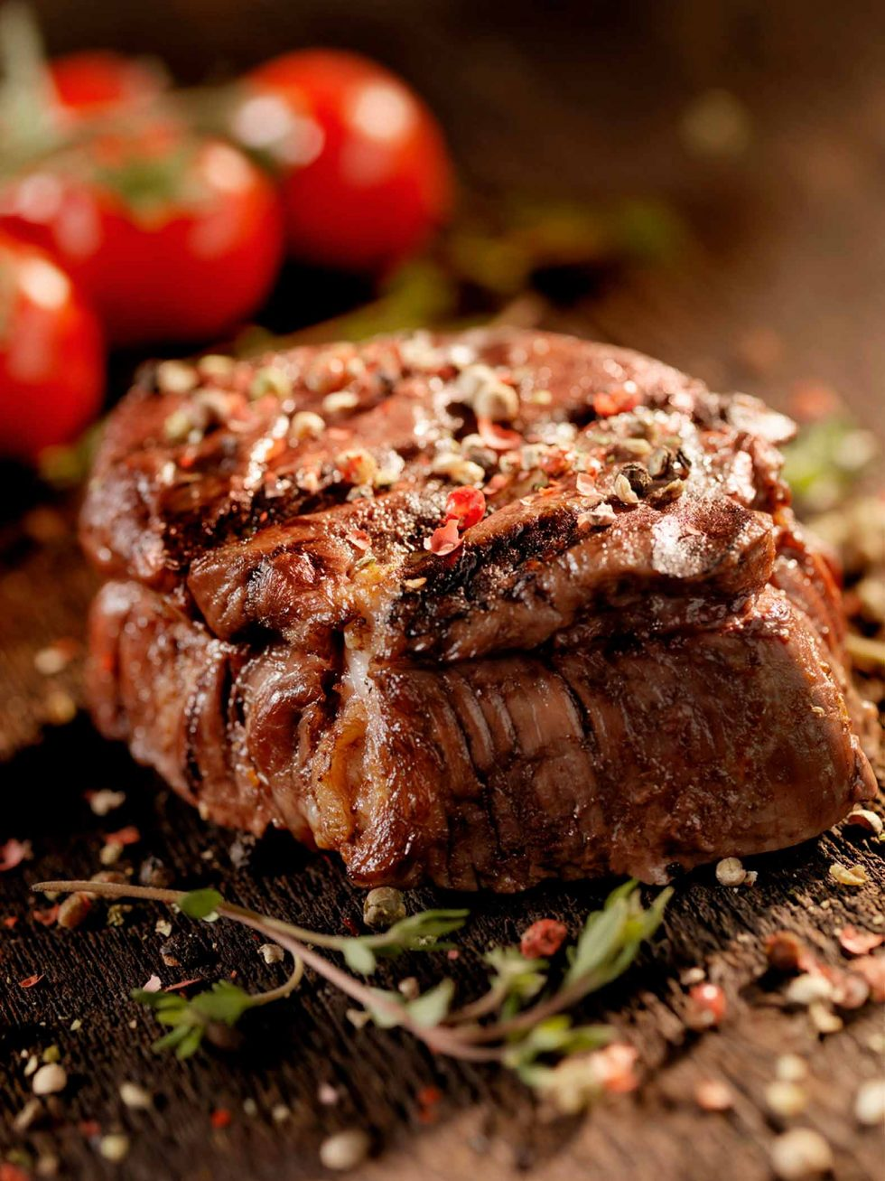 Calgary Food Photography. Perfectly cooked and seasoned steak, garnished on rustic backdrop.