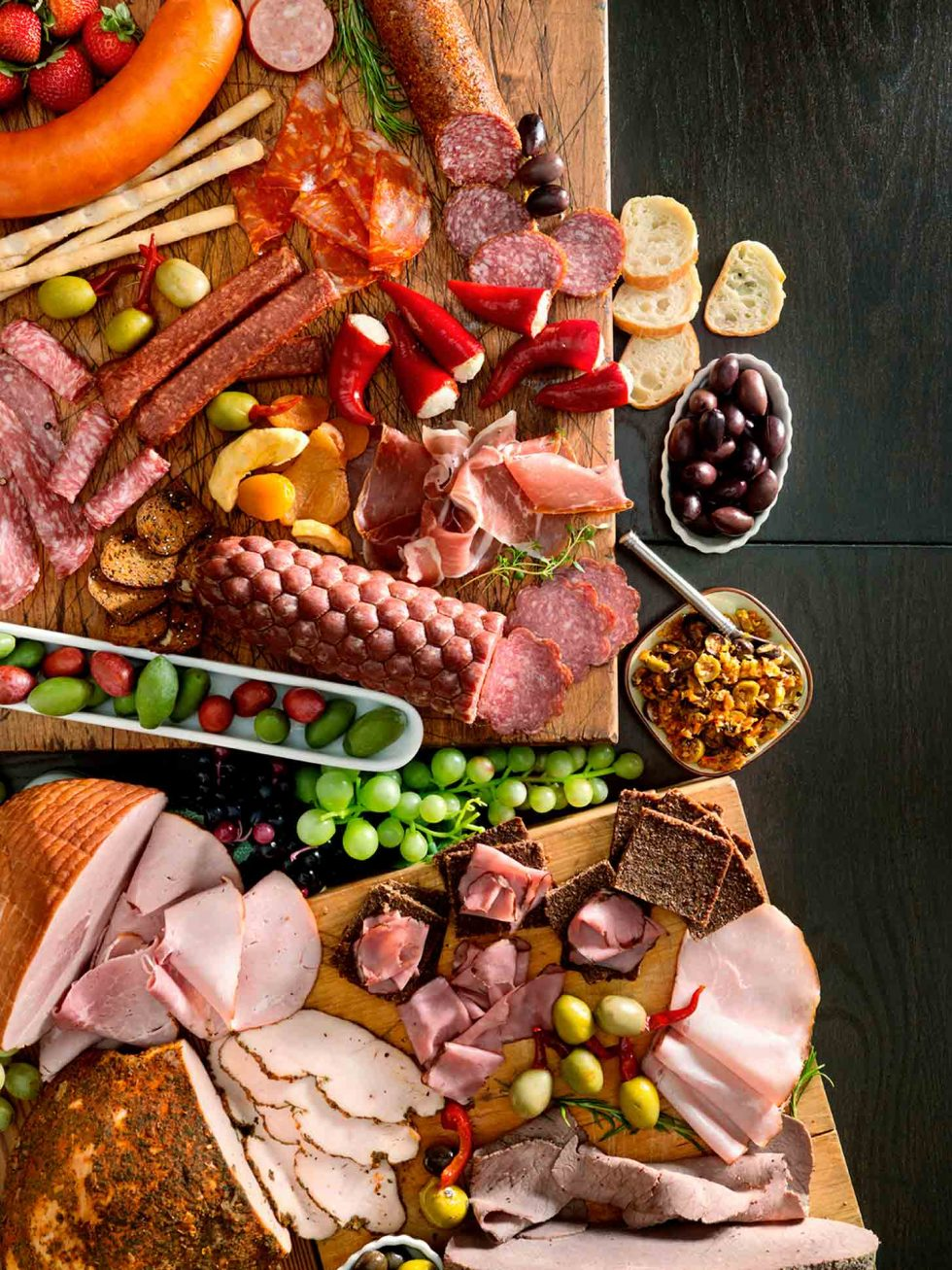 Calgary Food Photography. Rustic charcuterie display, assortment of cured meets with olives, breads and more.