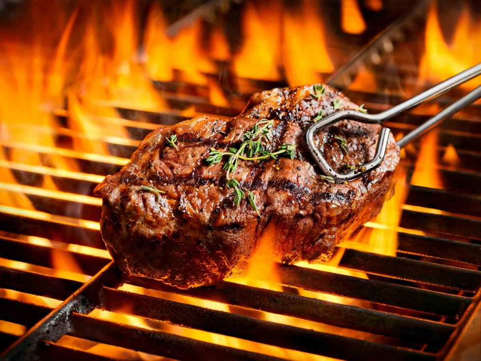 Calgary Food Photography. Seasoned steak on the barbeque with perfect grill marks.