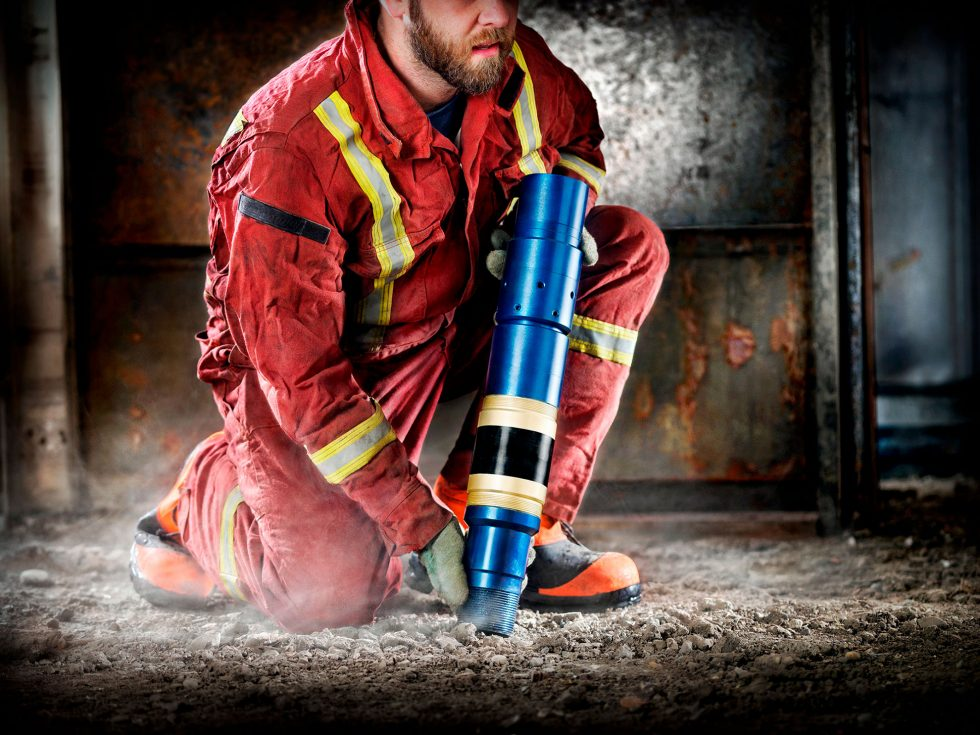 Calgary Onsite Photographer. Man onsite with steel canister.