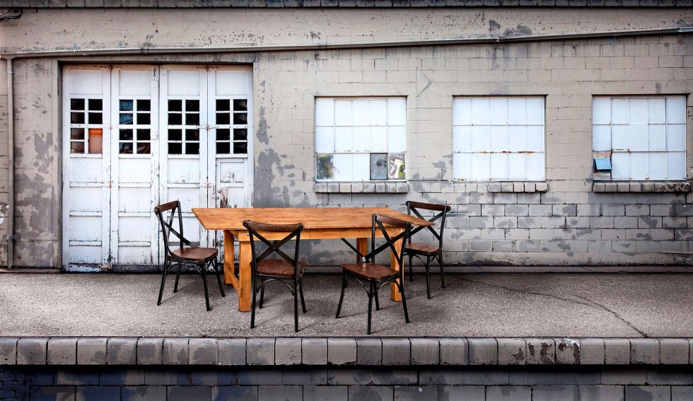 Calgary Onsite Photographer. Rustic dining table and chairs setup outdoors.