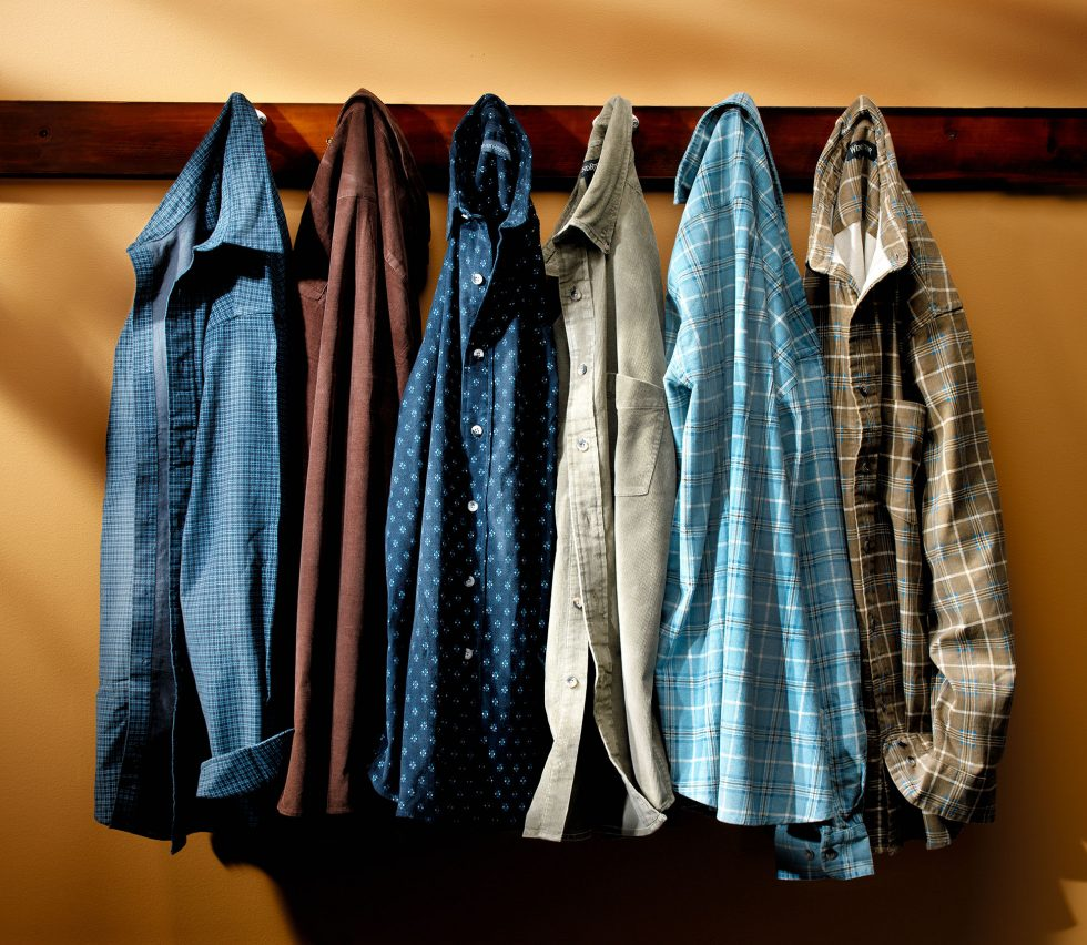 Calgary Product Photographer. Assortment of hanging men's dress shirts and flannels.
