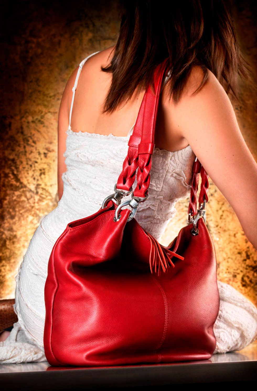 Calgary Product Photographer. Red leather bag.